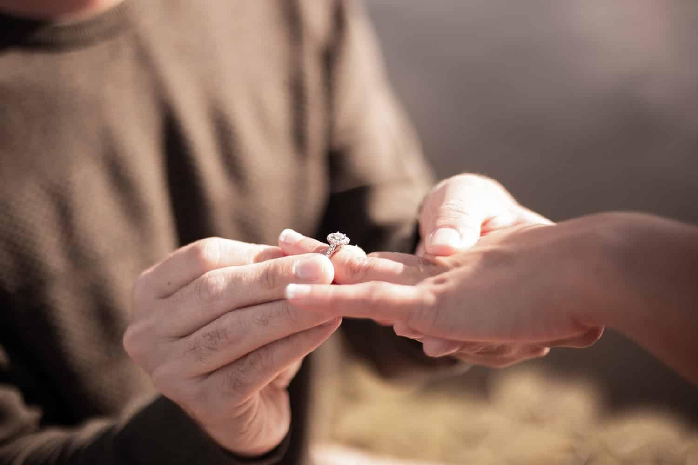caucasian hands engagement ring