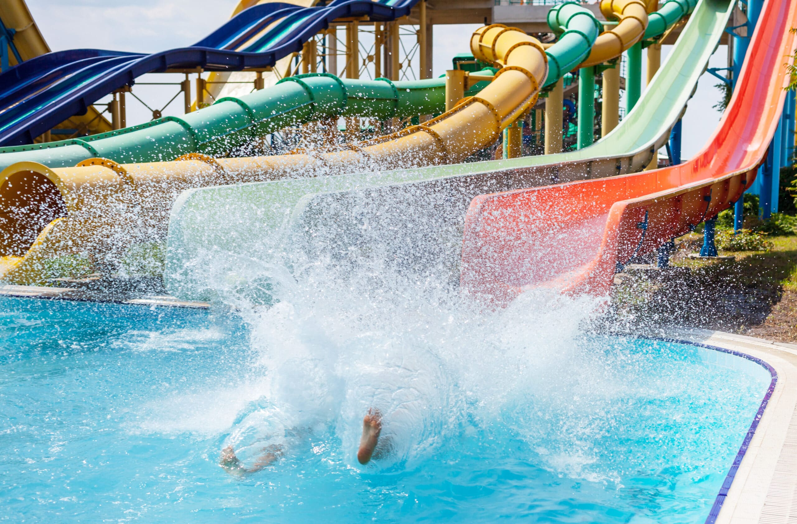 waterpark with waterslides and blue pool
